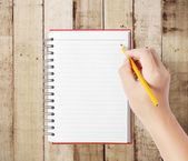 Pencil in hand rubber writting something — Stock Photo