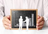 Holding blank chalkboard in hand — Foto Stock