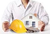 Building in  hand businessmen  — Stockfoto