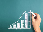 Business man drawing  graph — Stock Photo