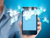 Moderno telefone celular na mão — Fotografia Stock