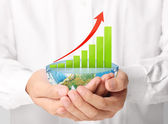 Graph on hand, local businessmen  — Stockfoto