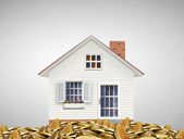 Mortgage concept by money house from coins  — Stock Photo