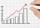 Business man tekening grafiek — Stockfoto
