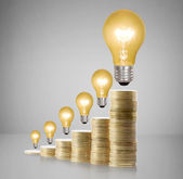 Money saved in different kinds of light bulbs  — Stock Photo