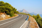 Winding Tarmac Road above blue sea — Stock Photo