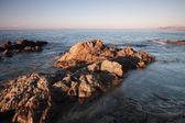 Coriscan rocks in sea at dusk — Stock Photo