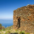 Old stone ruin overlooking mediterranean — Stock Photo