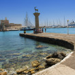 Rhodes Mandraki harbor with castle and symbolic deer statues, Greece — Stock Photo