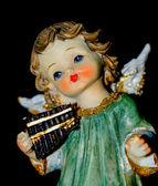 Angel with an instrument — Stock Photo