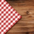 Tablecloth on wooden table background — Stock Photo #40214745