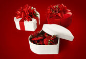 Valentine's Day and Christmas chocolate box (on red background). — Stock Photo