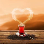 Turkish tea and enjoy the sunset (clipping path) — Stock Photo