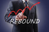 Businessman indicating the rebound — Stock Photo