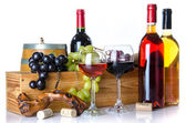 Composition with glasses and bottles of wine, a cask, corks, a c — Stock Photo