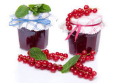 Two jars of redcurrant jam with fresh redcurrants and mint — Stock Photo