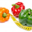 Measuring tape with different peppers — Stock Photo #46541109