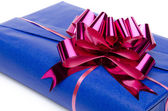 Blue gift box with a pink bow — Stock Photo