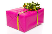 Pink gift box with a golden bow — Stock Photo