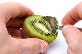 Eating kiwi with a spoon — Stock Photo