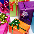 Colorful gift boxes with beautiful bows — Stock Photo #48158511