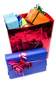 Colorful gift boxes in a bag — Stock Photo
