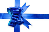Ribbon and shiny blue bow — Stock Photo