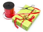 Composition of gift, scissors and ribbon — Stock Photo