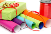 Composition of gift, paper and ribbon — Stock Photo
