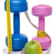 Dumbells and an apple with a tape measure — Stock Photo #48392489