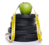 Apple on weights with a tape measure — Stock Photo