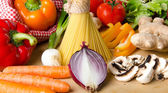 Composition of uncooked spaghetti and different types of vegetab — Stock Photo
