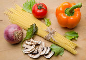 Composition of uncooked spaghetti surrounded by different types  — Stock Photo