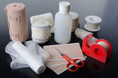 Different rolls of medical bandages and care equipment — Stock Photo