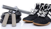 Dumbells, hand trainer and fitness shoes — Stock Photo