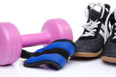 Pink dumbell, ankle weights and fitness shoes — Stock Photo