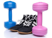 Dumbells and fitness shoes — Stock Photo