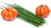 Beefsteak tomatoes with chive — Stock Photo