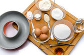 Ingredients to prepare a French ring cake, named savarin — Stockfoto