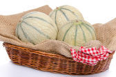 Melons in a basket — Stock Photo