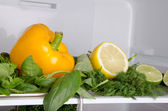Pepper and lemon inside a refrigerator — Stock Photo