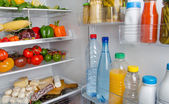 Different food products inside a refrigerator — Stock Photo