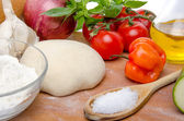 Different ingredients to make a pizza — Stock Photo