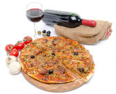 Composition with a pizza, a glass and a bottle of wine — Stock Photo