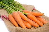 Fresh carrots on a burlap bag — Stockfoto