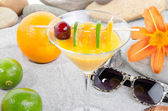 Healthy orange cocktail on a beach environment — Stock Photo