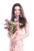 Beautiful girl with flowers on a white background — Foto de Stock