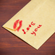 Stock Photo: Backside envelope with lipstick kiss