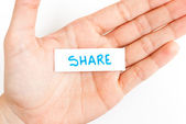 Showing share word — Stock Photo