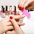 Stock Photo: Gentle care of nails in beauty salon